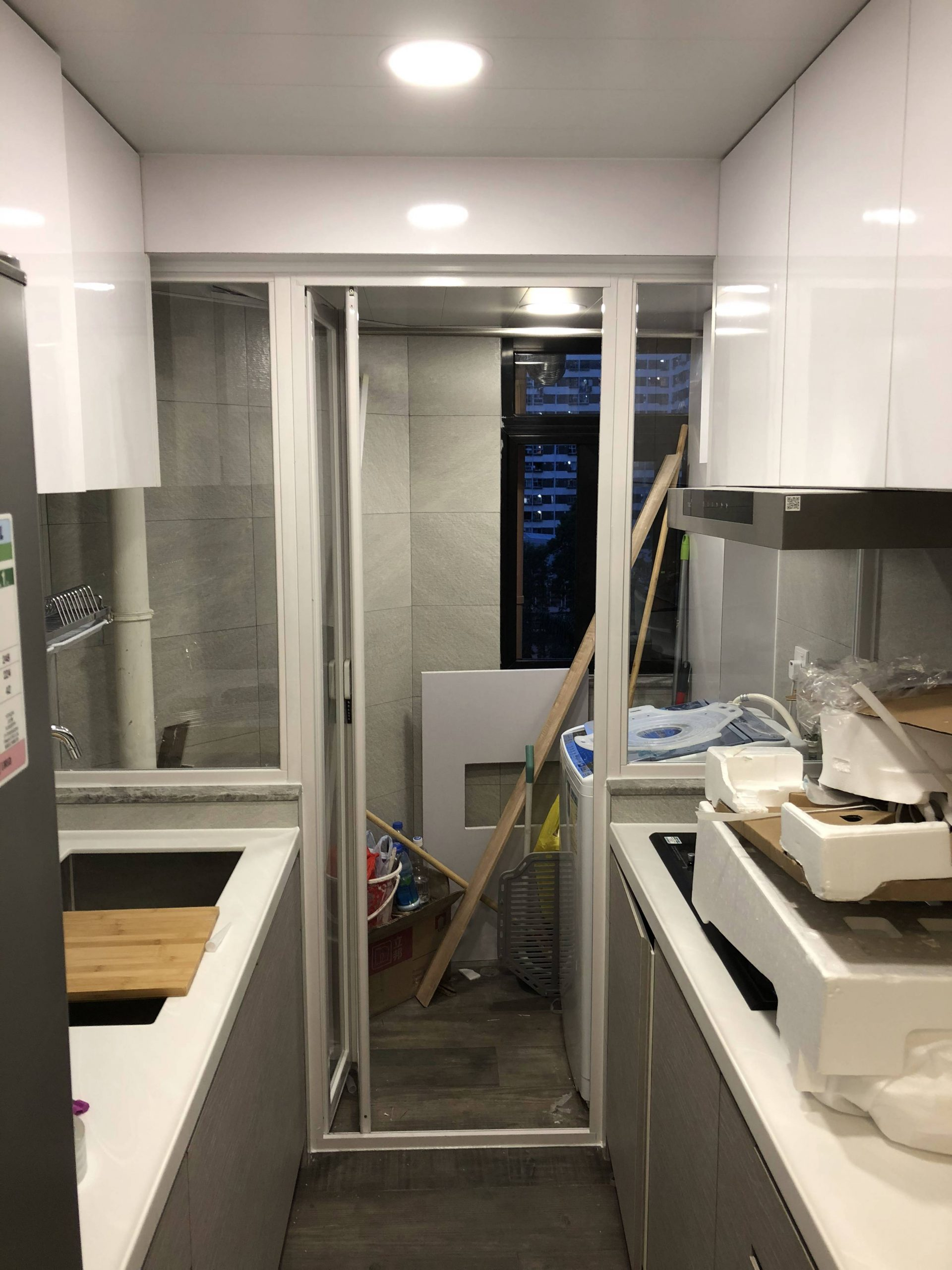 <p>Glass Partition between Cooking and Laundry Area (Opened)</p>